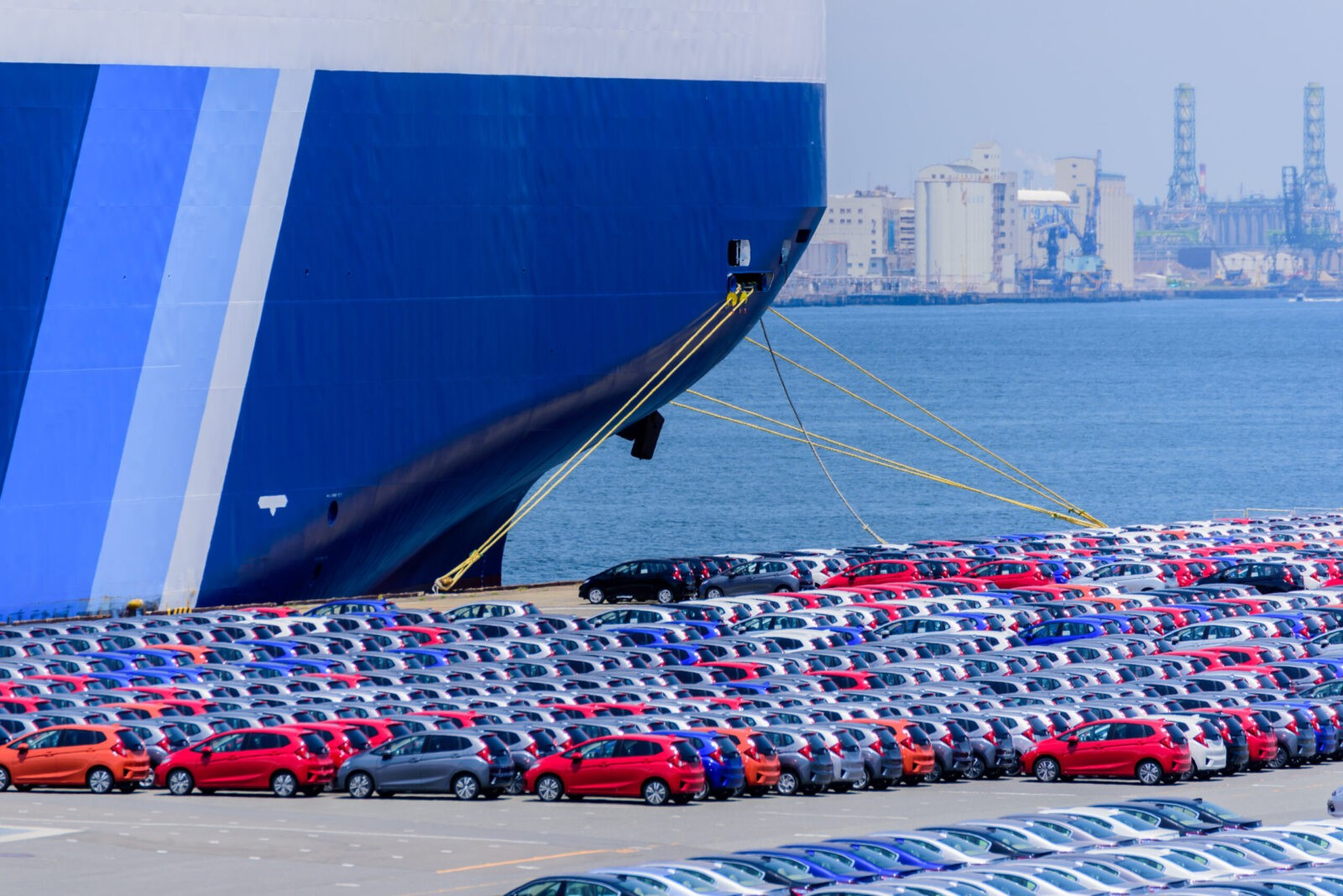Preparing to load an ocean freighter with vehicles